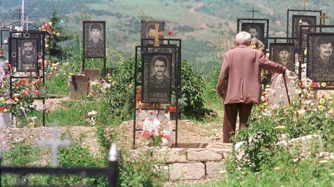 An Armenian man visits his son's grave at a memorial cemetery in Stepanakert, Azerbaijan, the capital of Nagorno Karabakh, in June 1994.