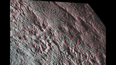 """New Horizons photographed what scientists are calling """"bladed"""" terrain near the heart-shaped region of the dwarf planet. This 3-D image was created using two images taken about 14 minutes apart on July 14. The first image was snapped about 16,000 miles (25,000 kilometers) from Pluto and the second was taken when the spacecraft was 10,000 miles (about 17,000 kilometers) away. Break out your 3-D glasses for the best view."""