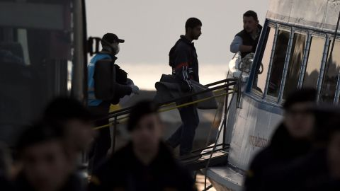 Migrants are deported to Turkey from the port of Mytilene on April 4.
