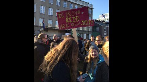 """I'm so angry I made a sign,"" one demonstrator's sign said."