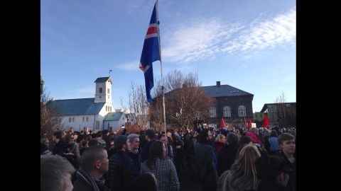 Some protesters waved Iceland's flag as they marched.