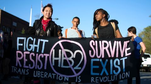 Mitch Xia, left, rallies with other organizers during a march on Franklin Street against N.C. House Bill 2 in Chapel Hill, N.C. on March 29, 2016. The new state law requires transgender people to use the restroom of their biological gender, not the gender with which they identify. (Whitney Keller/The Herald-Sun via AP)