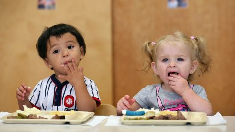 WOODBOURNE, NY - SEPTEMBER 20:  Infants eat lunch at the federally-funded Head Start school on September 20, 2012 in Woodbourne, New York. The school provides early education, nutrition and health services to 311 children from birth through age 5 from low-income families in Sullivan County, one of the poorest counties in the state of New York. The children receive 2/3 of their daily nutritional needs through meals, which include breakfast, lunch and snack, that are prepared at the school and served family-style in classrooms. The county Head Start Program was expanded with a $1 million grant from President Obama's 2009 stimulus bill, the American Recovery and Reinvestment Act. Head Start, administered by the U.S. Department of Health and Human Services, is the longest-running early education program for children of low-income families in the United States.  (Photo by John Moore/Getty Images)