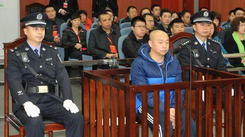 18-year-old Huugjilt was executed for a crime Zhao Zhihong (center) later confessed to.