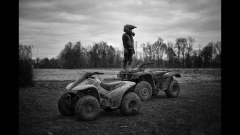 """Tharin surveys the area from atop a four-wheeler. He's obsessed with his four-wheeler and will venture all over the farm, his mother said. """"His grandpa has one, his uncle has one, he thinks he needs a bigger and better one,"""" she said. """"He will literally ride that four-wheeler all day long, till he runs out of gas."""""""