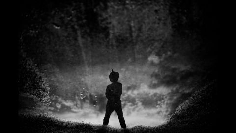 """""""We had a big storm blow through before bed,"""" Habing said of this photo. """"After it passed, (Tharin) ran outside in his PJs with his Batman mask. He stood right in front of a massive puddle and struck the Batman pose."""""""