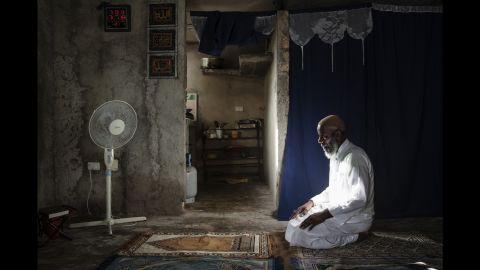 Ahmed Aguero prays in Camaguey.