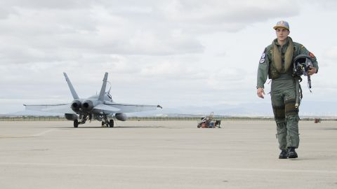 Rider Maverick Vinales swaps his motorcycle for a plane in this photoshoot resembling his Top Gun namesake.