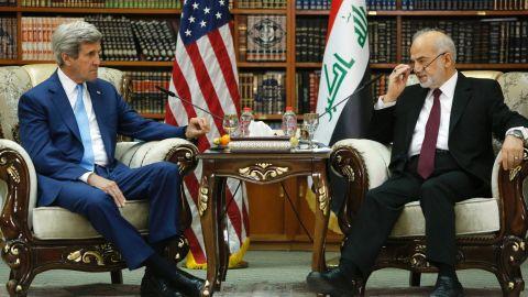Iraq's Foreign Minister Ibrahim al-Jaafari receives U.S. Secretary of State John Kerry in the library at the foreign minister's villa in Baghdad on April 8, 2016.
