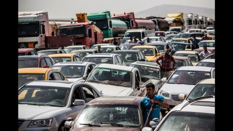 """Traffic from Mosul lines up at a checkpoint in Kalak, Iraq, on June 14, 2014. Thousands of people <a href=""""http://www.cnn.com/2014/07/19/world/meast/christians-flee-mosul-iraq/"""" target=""""_blank"""">fled Mosul</a> after it was overrun by ISIS."""