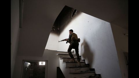 """An Iraqi soldier searches for ISIS fighters in Tikrit on March 30, 2015. Iraqi forces <a href=""""http://www.cnn.com/2015/03/31/middleeast/iraq-isis-tikrit/index.html"""" target=""""_blank"""">retook the city</a> after it had been in ISIS control since June 2014."""