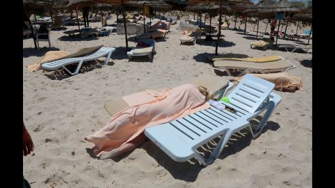 """Dead bodies lie near a beachside hotel in Sousse, Tunisia, after <a href=""""http://www.cnn.com/2015/06/26/world/gallery/tunisia-terrorist-attack/index.html"""" target=""""_blank"""">a gunman opened fire</a> on June 26, 2015. ISIS claimed responsibility for the attack, which killed at least 38 people and wounded at least 36 others, many of them Western tourists. Two U.S. officials said they believed the attack might have been inspired by ISIS but not directed by it."""