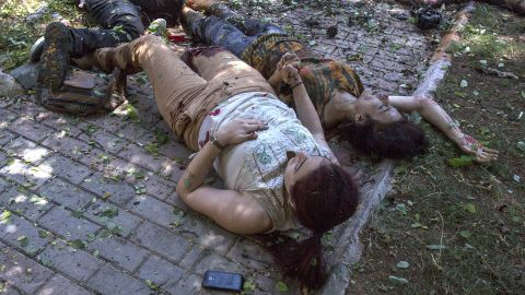 """Two women hold hands after an explosion in Suruc, Turkey, on July 20, 2015. The blast <a href=""""http://www.cnn.com/2015/07/22/world/turkey-suruc-explosion/index"""