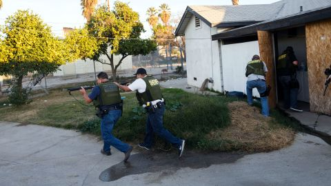 """Law enforcement officers search a residential area in San Bernardino, California, after a <a href=""""http://www.cnn.com/2015/12/02/us/gallery/san-bernardino-shooting/index.html"""" target=""""_blank"""">mass shooting</a> killed at least 14 people and injured 21 on December 2, 2015. <a href=""""http://www.cnn.com/2015/12/03/us/san-bernardino-shooting/index.html"""" target=""""_blank"""">The shooters</a> -- Syed Rizwan Farook and his wife, Tashfeen Malik -- were fatally shot in a gunbattle with police hours after the initial incident. The couple supported ISIS and had been planning the attack for some time, investigators said."""