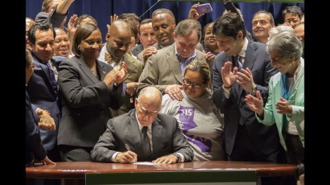 """California Gov. Jerry Brown signs legislation Monday, April 4, that makes his state <a href=""""http://money.cnn.com/2016/03/31/pf/california-minimum-wage/"""" target=""""_blank"""">the first in the nation</a> to raise the minimum wage to $15 an hour."""