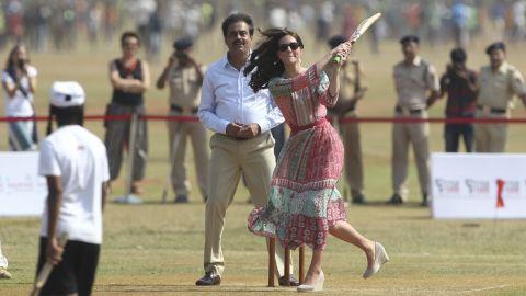 The duchess plays cricket with cricket legend Sachin Tendulkar at the Oval Maidan sporting ground in Mumbai on April 10.