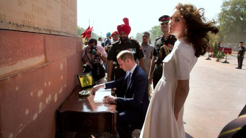 William signs a visitors book at the India Gate war memorial on April 11.