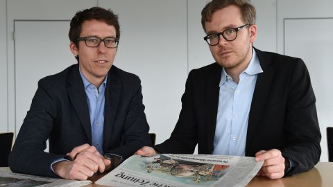 """German journalists Bastian Obermayer (R) and Frederik Obermaier (L) co-authors of the socalled """"Panama Papers"""" investigation pose on April 7, 2016 in Munich, southern Germany, at the office of the German daily """"Sueddeutsche Zeitung"""". The Panama Papers are a massive leak of 11.5 million documents allegedly exposing the secret offshore dealings of aides to Russian president Vladimir Putin, world leaders and celebrities including Barcelona striker Lionel Messi. The vast stash of records was obtained from an anonymous source by German daily Sueddeutsche Zeitung and shared with media worldwide by the International Consortium of Investigative Journalists (ICIJ).  / AFP / CHRISTOF STACHE        (Photo credit should read CHRISTOF STACHE/AFP/Getty Images)"""