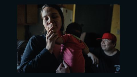 Inyan, 34, Cody's wife with their newborn daughter Sincere. Two of Inyan's younger children were born on a scheduled Cesarian, because the closest birthing center is in Pierre, two hours away.
