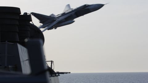 A Russian Sukhoi Su-24 attack aircraft makes a very-low altitude pass by the USS Donald Cook (DDG 75) April 12. Donald Cook, an Arleigh Burke-class guided-missile destroyer, forward deployed to Rota, Spain is conducting a routine patrol in the U.S. 6th Fleet area of operations in support of U.S. national security interests in Europe.