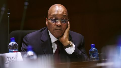 South African President Jacob Zuma listens to a speaker during the second sitting of the session of the fifth national house of traditional leaders at Tshwane Council Chambers in Pretoria on April 7, 2016.  Zuma easily survived an impeachment vote on April 5 after a stormy session of parliament over a court ruling that he had violated the country's post-apartheid constitution. Lawmakers from Zuma's African National Congress (ANC) rallied to his defence, defeating the motion by 233 votes to 143 despite growing pressure for him to resign over the scandal.  / AFP / STRINGER        (Photo credit should read STRINGER/AFP/Getty Images)