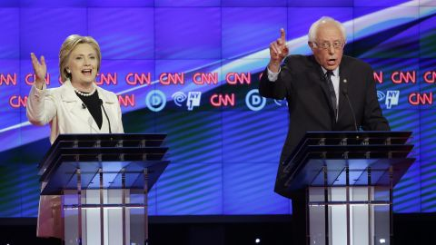Democratic presidential candidates Sen. Bernie Sanders, I-Vt., right, and Hillary Clinton speak during the CNN Democratic Presidential Primary Debate at the Brooklyn Navy Yard on Thursday, April 14, 2016 in New York. (AP Photo/Seth Wenig)