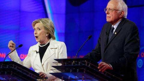 Hillary Clinton, left, speaks while Sen. Bernie Sanders, I-Vt., listens during the CNN Democratic Presidential Primary Debate at the Brooklyn Navy Yard on Thursday, April 14, 2016 in New York. (AP Photo/Seth Wenig)