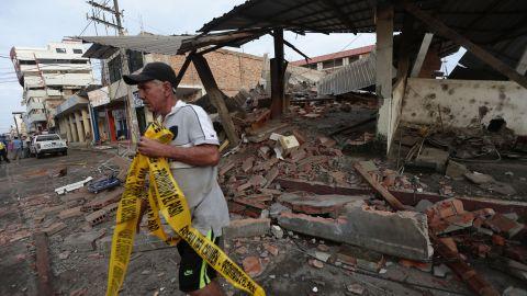 A man takes in the damage in Portoviejo on April 17.