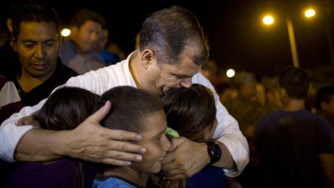 Ecuadorian President Rafael Correa kisses a group of children after meeting with local authorities at the emergency center in Portoviejo on Sunday, April 17.