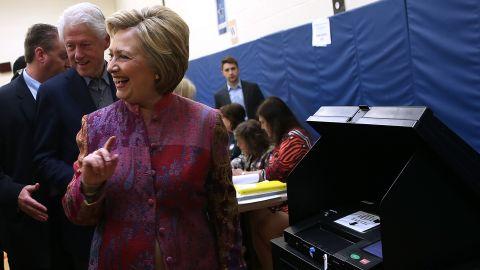 Democratic presidential candidate former Secretary of State Hillary Clinton and her husband former U.S. president Bill Clinton casts her ballot at Douglas Grafflin Elementary School on April 19, 2016 in Chappaqua, New York.