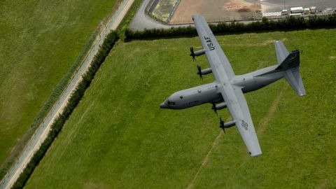 A C-130J Super Hercules from the 37th Airlift Squadron flies over Normandy, France, June 3, 2015. First delivered to the Air Force in 1956, the C-130 remains one of the service's most important airlift platforms. More than 140 are still in active units, with more than 180 in the National Guard and a hundred more in the Reserve. The C-130 is powered by four turboprop engines.