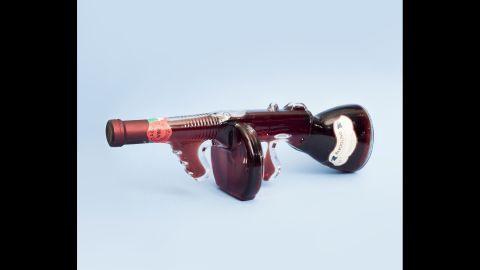 A wine bottle shaped like a machine gun.