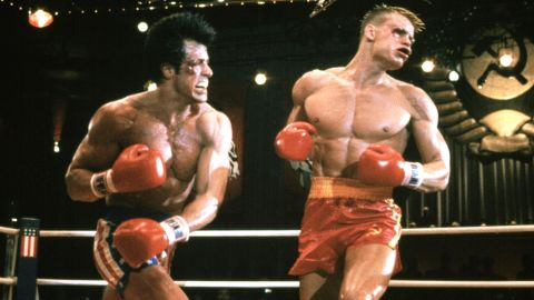 """Hey, your name is Rocky Balboa and a super-scary Soviet boxer named Ivan Drago kills your best friend Apollo Creed during a boxing match, see? What are ya gonna do about it? Challenge him to a mano-a-mano, globally broadcast revenge match, OF COURSE!  Arguably, """"Rocky IV"""" is the masterpiece of Sylvester Stallone's long-running franchise. Why? Three things: Glitter, glory and guts."""