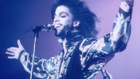 """The singer's predilection for lavishly kinky story-songs earned him the nickname """"His Royal Badness."""" He is also known as the """"Purple One"""" because of his colorful fashions. He is seen here in 1990."""