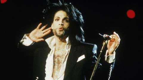 Prince listens to the crowd during a 1991 concert.