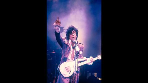 """Prince performs in New York in 1984. Controversy followed the singer and that, in part, made his fans adore him more. His 1984 song, """"Darling Nikki,"""" details a one-night stand and prompted the formation of the Parents Music Resource Center. Led by Al Gore's then-wife, Tipper Gore, the group encouraged record companies to place advisory labels on albums with explicit lyrics."""