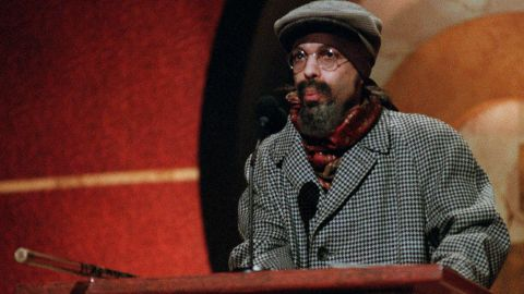 A disguised Prince speaks at GQ magazine's third annual Men of the Year Awards in 1998.