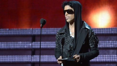 Prince presents the winner for Record of the Year to Gotye and Kimbra during the 55th Grammy Awards in 2013.