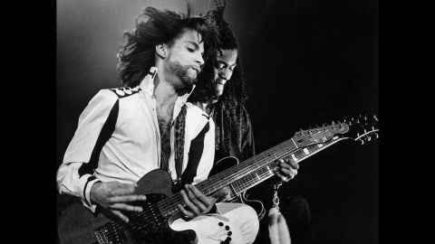 """Prince performs during """"The Nude Tour"""" in Birmingham, United Kingdom, in 1990."""