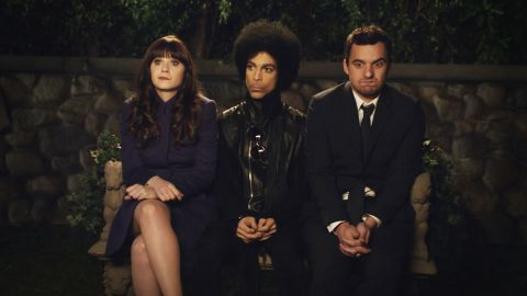 """Left to right: Zooey Deschanel, Prince, and Jake Johnson in a scene from the TV show """"New Girl"""" which aired in 2014."""