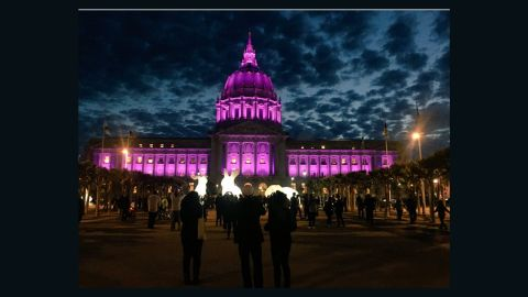 San Francisco's City Hall is seen bathed in purple light.