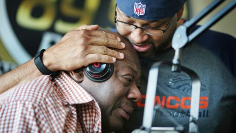 """KMOJ DJs Walter """"Q Bear"""" Banks, left, and Shed G embrace as they talk about the death of Prince on April 21."""