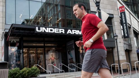 A man runs in front of Under Armour's Inner Harbor flagship store. The Baltimore-based sports apparel company is one of the city's few economic success stories, growing more than 28% in 2015.<br />