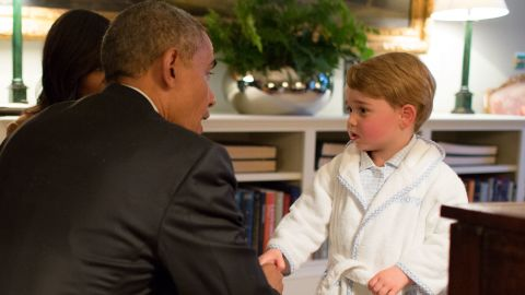 Obama, Prince William and first lady Michelle Obama talk with Prince George at Kensington Palace on Friday, April 22.