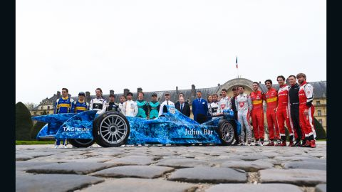 Formula E drivers pose for a photo outside the Hotel des Invalides on the eve of the race.