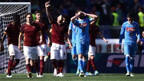 Roma's midfielder Radja Nainggolan celebrates after his goal ended Napoli's slim title hopes.