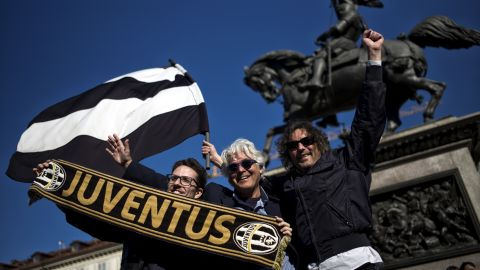 """Juventus supporters celebrate in Turin after the club's latest """"Scudetto"""" triumph."""