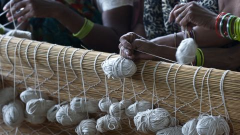 Indian weavers make bamboo blinds in the old quarter of New Delhi.