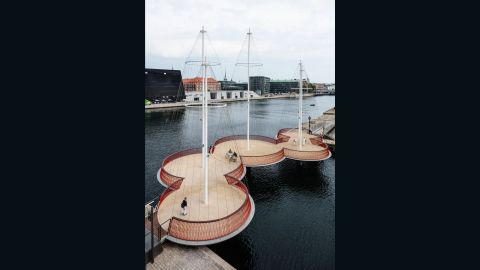 """Artist <a href=""""http://www.olafureliasson.net/"""" target=""""_blank"""" target=""""_blank"""">Olafur Eliasson</a> was inspired by the city's history as a port town when he designed Cirkelbroen. The five round platforms and wired masts give the illusion of boats floating on the harbor."""