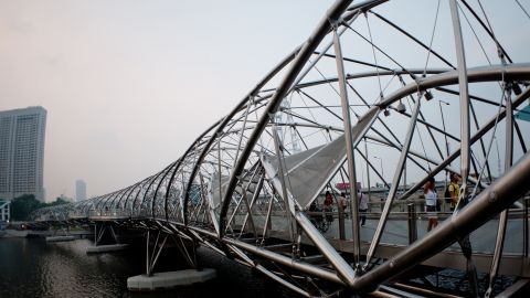 """When it opened in 2010, Singapore's Helix Bridge was the first to incorporate the shape of a double-helix. The structure is meant to symbolize life, renewal and growth, and sits near Moshe Safdie's <a href=""""http://edition.cnn.com/2015/04/20/travel/moshe-safdie-interview-destination-singapore/"""">$5.7 billion Marina Bay Sands casino</a>."""